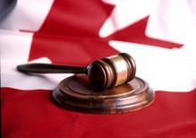 gavel on top of Canadian flag