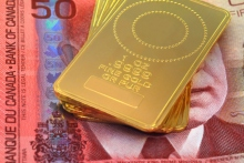 Picture of ounces of gold on a $50 Canadian dollar note. Photo: Thinkstock.com