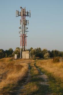 Telecommunications transmitter in a field. Photo: Thinkstock.com