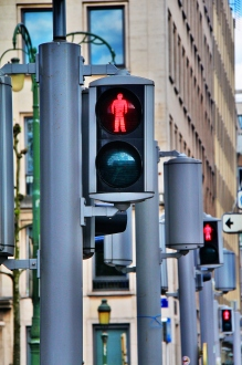 Image showing red traffic lights on a busy street in a downtown area. Thinkstock.com